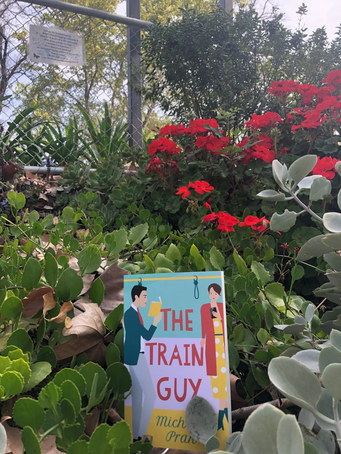 The Train Guy novel in train station greenery