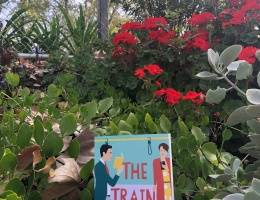 The Train Guy novel in train station greenery